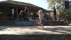 A small girl dancing on a stage between sets in Ojai, California. Stock Footage