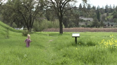 A girl walking through a restored wetlands at the Ojai Meadow Preserve in Ojai Stock Footage