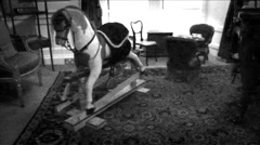 Scary Rocking Horse In Haunted Playroom Stock Footage