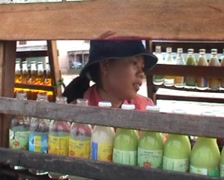 Girl in boat at floating market Stock Footage