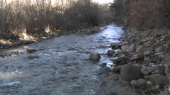 Pan of people testing the water flowing in San Antonio Creek in Ojai Stock Footage