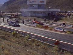 Motorsports, NHRA Drag racing, top alcohol funny car race semifinals Stock Footage