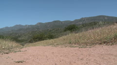 Low angle of man trail running on the Ventura River Preserve in Ojai Stock Footage