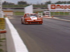 Motorsports, GT roadcourse race fast cars, very fast Oldsmobile, whip pan Stock Footage