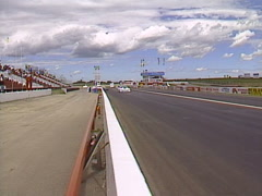 Motorsports, GT roadcourse race, fast cars on the front straight, pan 2nd Stock Footage