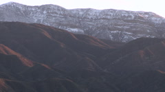 Zoom out of the snow covered Topatopa Mountain above Ojai, California. Stock Footage