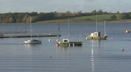 Boats moored to buoys on Rutland water. Ripples. Stock Footage