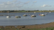 Stock Video Footage of Boats moored to buoys near marina on Rutland Water.