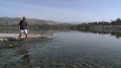 Man discussing the steelhead migration up the Ventura River Estuary Stock Footage