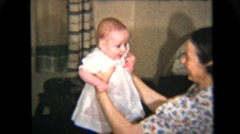 Proud Mother Holds Her Baby Girl (1939 Vintage 8mm) - stock footage