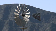 Spinning windmill drawing water from a well in Ojai, California. Stock Footage