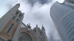 Tower block and church with clouds time lapse Stock Footage