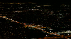 Aerial view of a city at night from a plane - stock footage