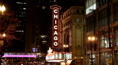 Street view of the vertical Chicago Theater neon sign at night - stock footage