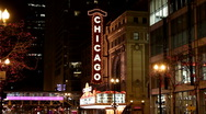 Street view of the vertical Chicago Theater neon sign at night Stock Footage
