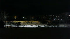 People skating on ice-rink, night view Stock Footage