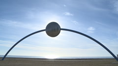 Sunrise arch at sunrise with unicycle Stock Footage