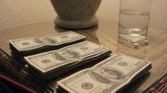 Black Gloved Hand Grabbing Piles of Cash from Table Stock Footage