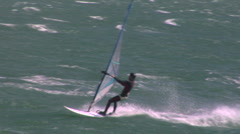 Windsurfer jumps wave Stock Footage