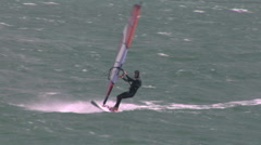 Blustery conditions for a windsurfer Stock Footage