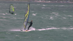 Windsurfer approaches camera Stock Footage