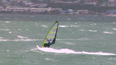 Windsurfer spins falls off Stock Footage