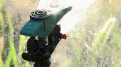 Close up of sprinkler spraying water in Oak View, California. Stock Footage