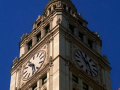 Chicago's Landmark Wrigley Building Clock Tower Day to Night 400x300 Stock Footage