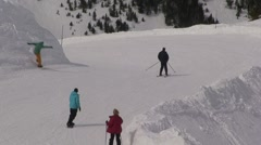 Skiers on an Alpine Bend Stock Footage