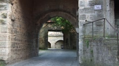 Archway in Rotenberg (Germany) with car - stock footage