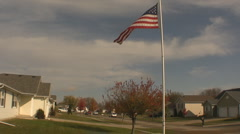 American Flag in a Neighborhood - Flag Pole, blowing in wind Stock Footage