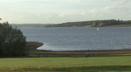 Distant dinghy crosses Rutland Water. Stock Footage