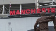 Stock Video Footage of Manchester United Sign Behind Statue