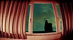 Looking through window at timelapse roofline Stock Footage