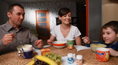 Happy Family lunch. Eating food - stock footage