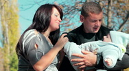 Father holds the baby in her arms Stock Footage