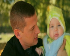 Father Holding Baby - stock footage