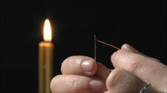 Thread is inserted into the needle Stock Footage
