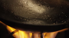 Stock Video Footage of Oil poured into a wok