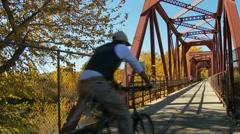 biker on bridge - stock footage