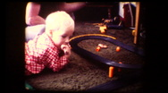 Stock Video Footage of Cute little blonde boy with racing cars