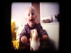 Cute little blonde boy on rocking horse claps - stock footage