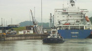 Stock Video Footage of Panama Canal: ship and tug enter locks