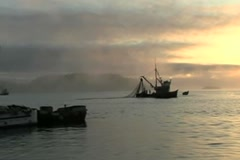 Fishing boats at sunset Stock Footage