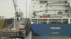 Panama Canal: snug fit for container ship in locks Stock Footage