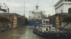 Panama Canal: tug enters Pedro Miguel lock Stock Footage