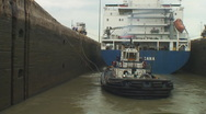 Stock Video Footage of Panama Canal: Lock workmen secure tug lines