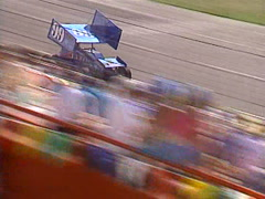 Motorsports - Sprint car race follow car close up with fans  Stock Footage