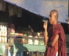 Monk smoking Stock Footage