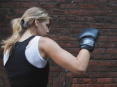 Stock Video Footage of Female boxer. 3 shots.SD.